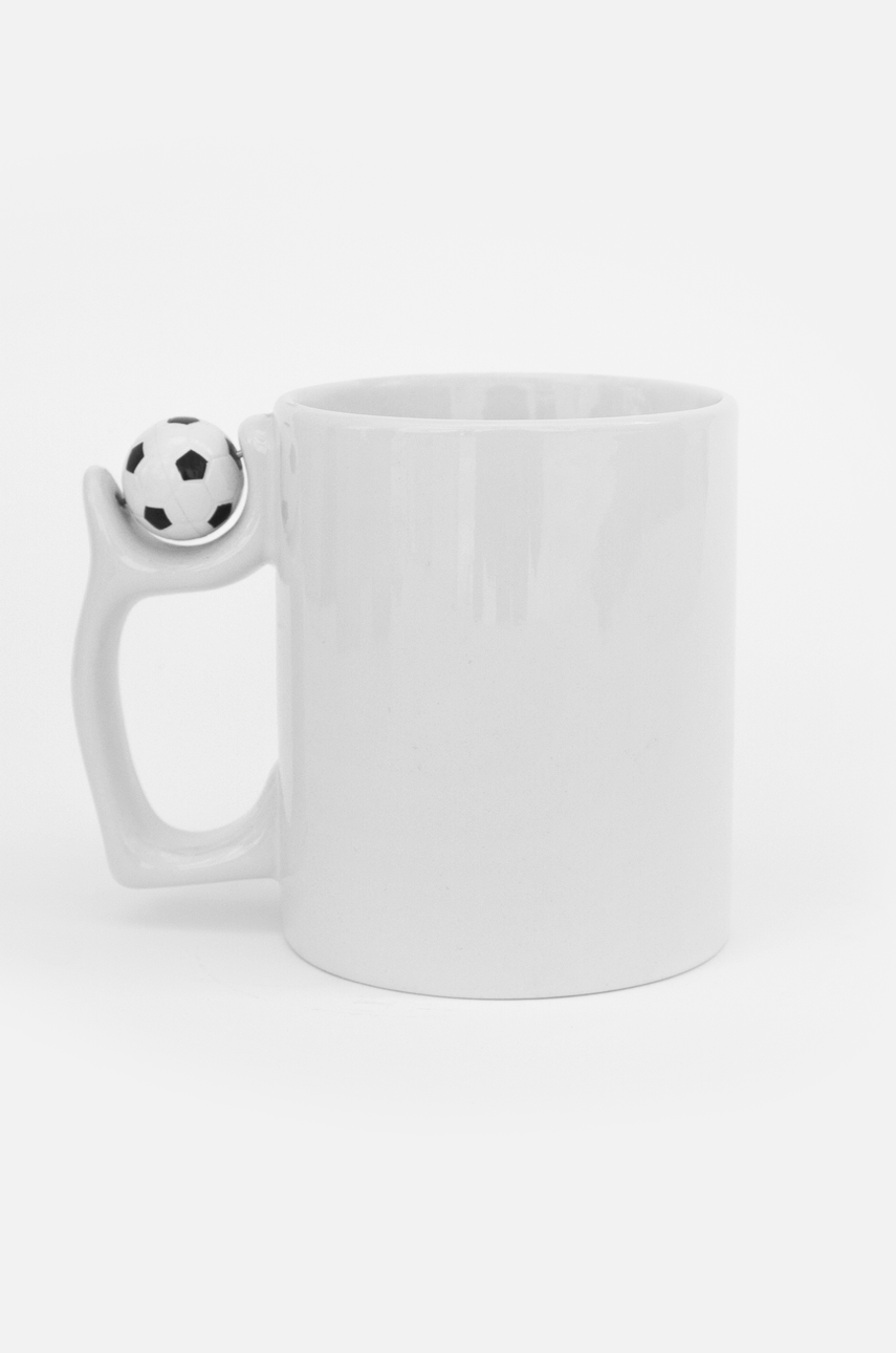 Mug with a soccer ball on the handle